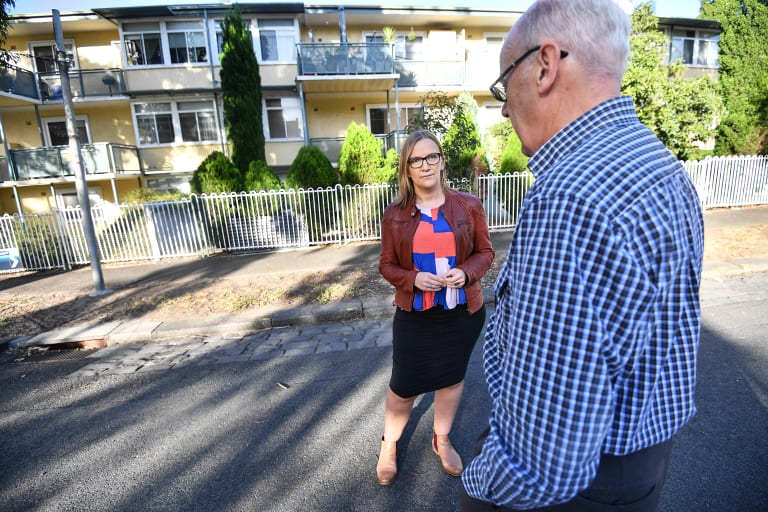 Les in front of his former North Melbourne home, with Inner Melbourne Community Legal lawyer Molly Williams, from Inner Melbourne Community Legal.