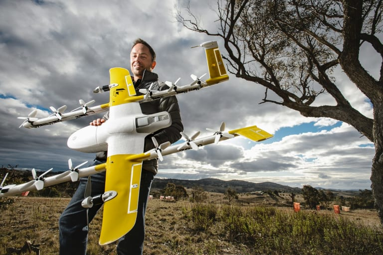 Wing chief executive James Ryan Burgess with one of the delivery drones.