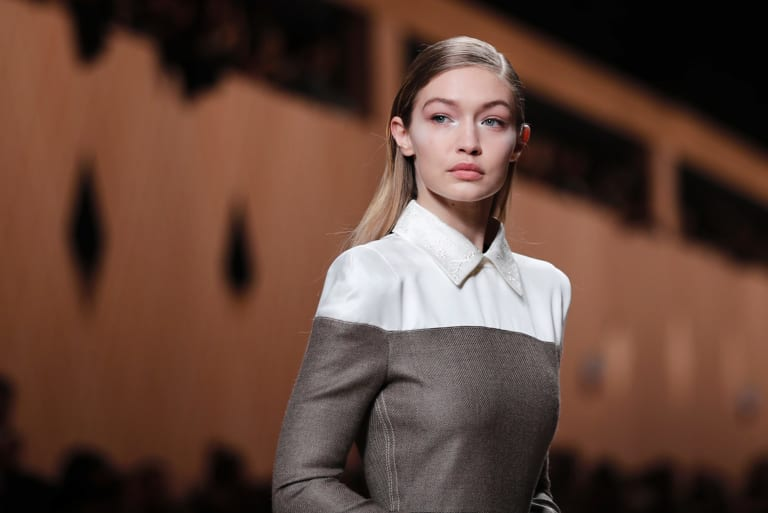 Gigi Hadid has been criticised for appearing in excessive bronzer on the cover of Vogue Italia.