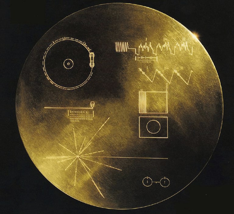 The cover of the gold-plated copper disc Voyager is carrying into space.