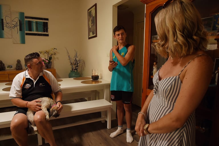 Cameron Haywood and his wife Kristy with their eldest son Lachlan at their Erskine Park home.