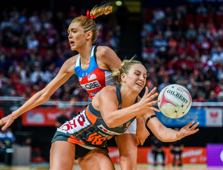 No quarter given: Jamie-Lee Price, right, of the Giants competes for possession against Helen Housby of the Swifts.