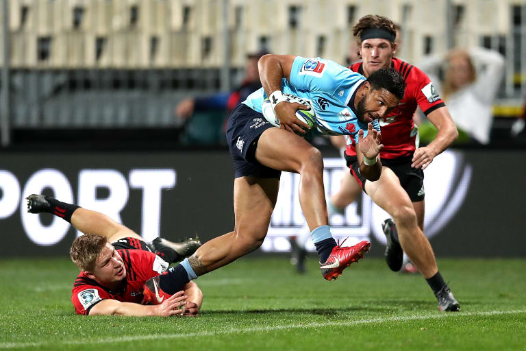 Breakthrough: Curtis Rona slips a Crusaders tackle.