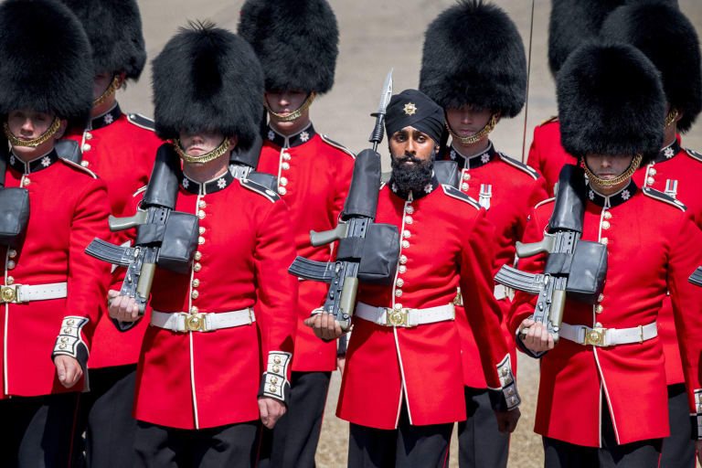 Charanpreet Singh Lall, one of the Coldstream Guards marches, wearing a turban.