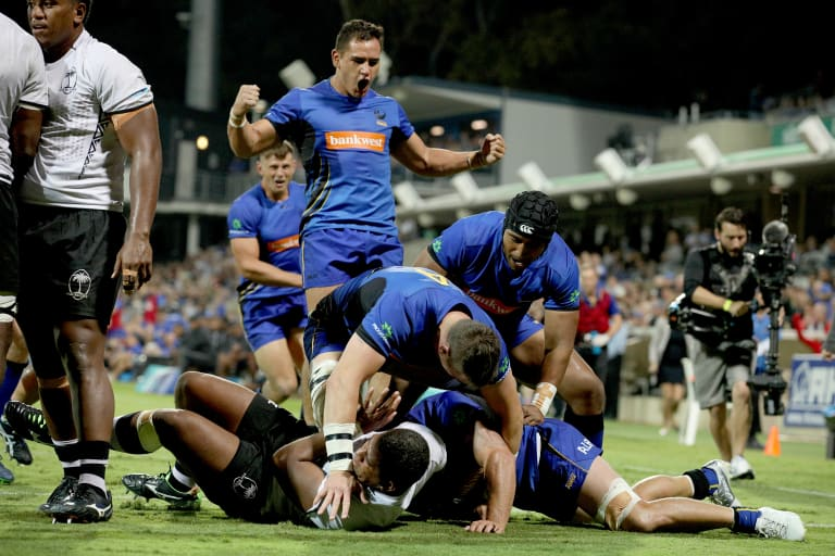 Back in action: Force players celebrate a try by Brynard Stander during their win over Fiji.