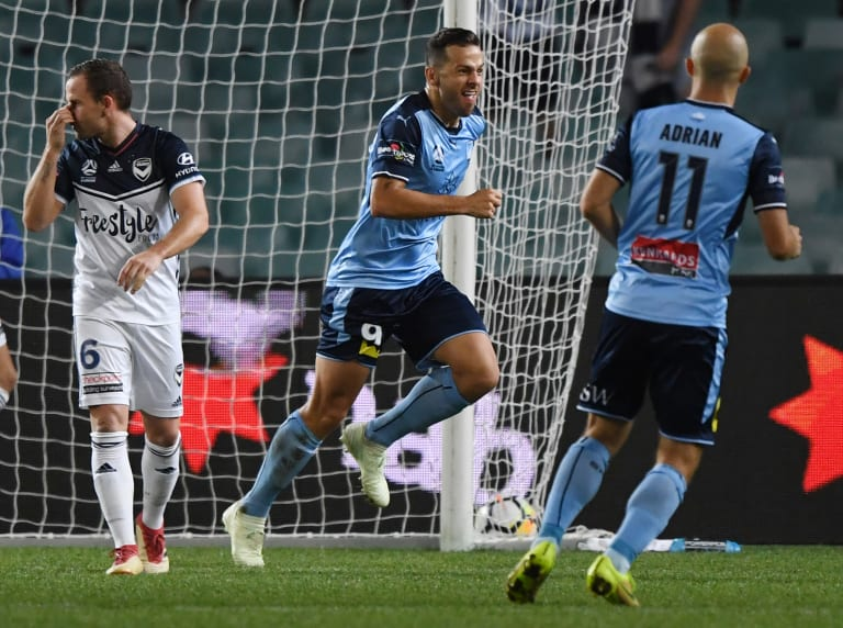 In again: Leading goalscorer Bobo puts Sydney in front against Victory.