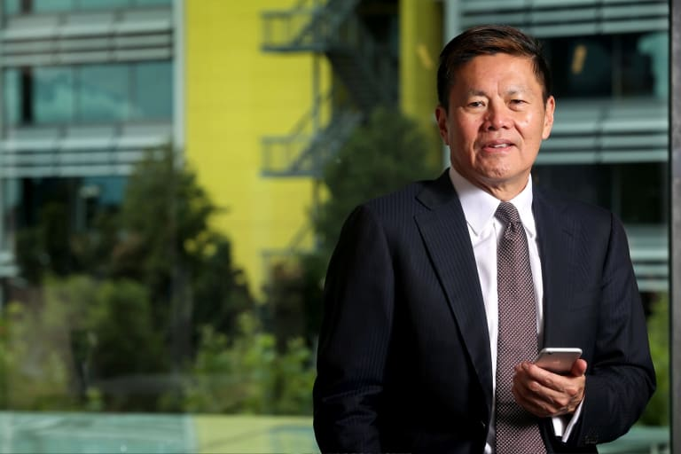 Singtel-Optus chief executive Allen Lew has plans to broaden the telco's offerings into the media with more exclusive soccer.