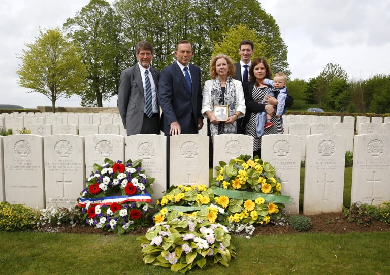 Former prime minister Tony Abbott attended the headstone dedication ceremony for Corporal Athol Kirkland, along with the soldier's relatives in 2015.