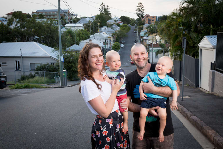 Phoebe Meredith with her husband Alex Wallace and their 18-month-old twins Hamish (stripe shirt) and Xavier (blue shirt) at their Brisbane home.