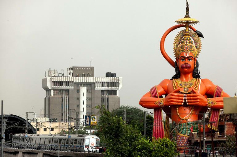A huge statue of Hanuman looms over a Delhi railway station.