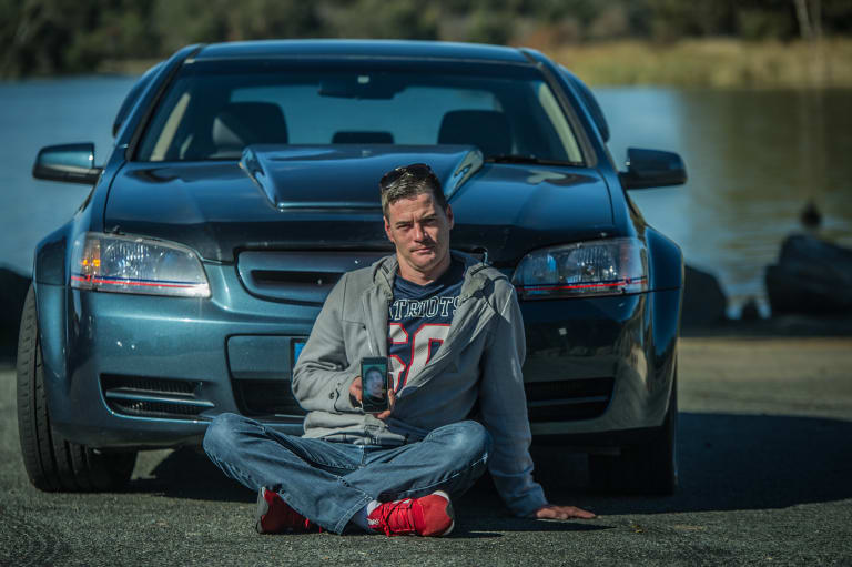 Justin Hogg in front of his prized Holden Commodore, which he is taking on a car cruise he has organised for Saturday in memory of his brother Adrian, who died in a motorbike crash.
