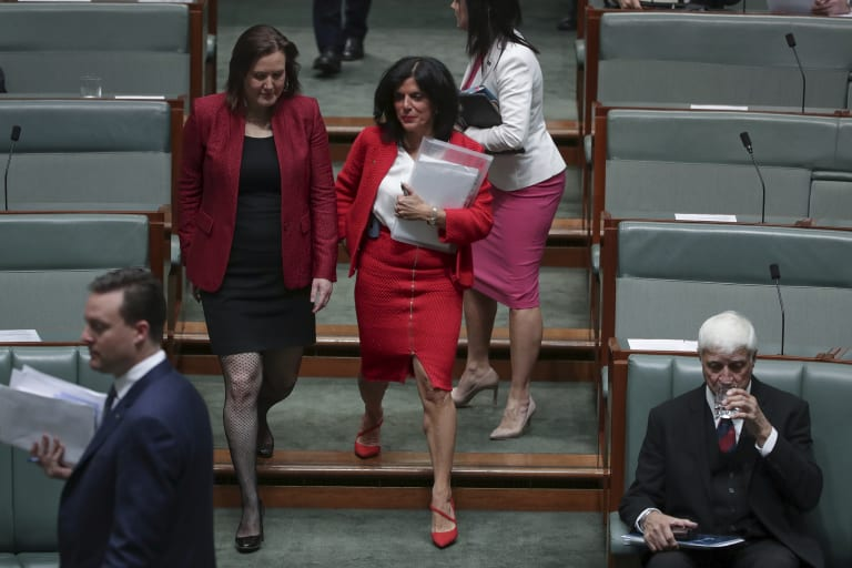 Women in red: Kelly O'Dwyer and Julia Banks in parliament.