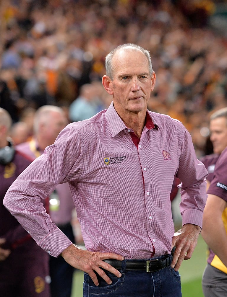 Is that a hint of a smile: Broncos coach Wayne Bennett watches on as his team celebrates victory over the Roosters.