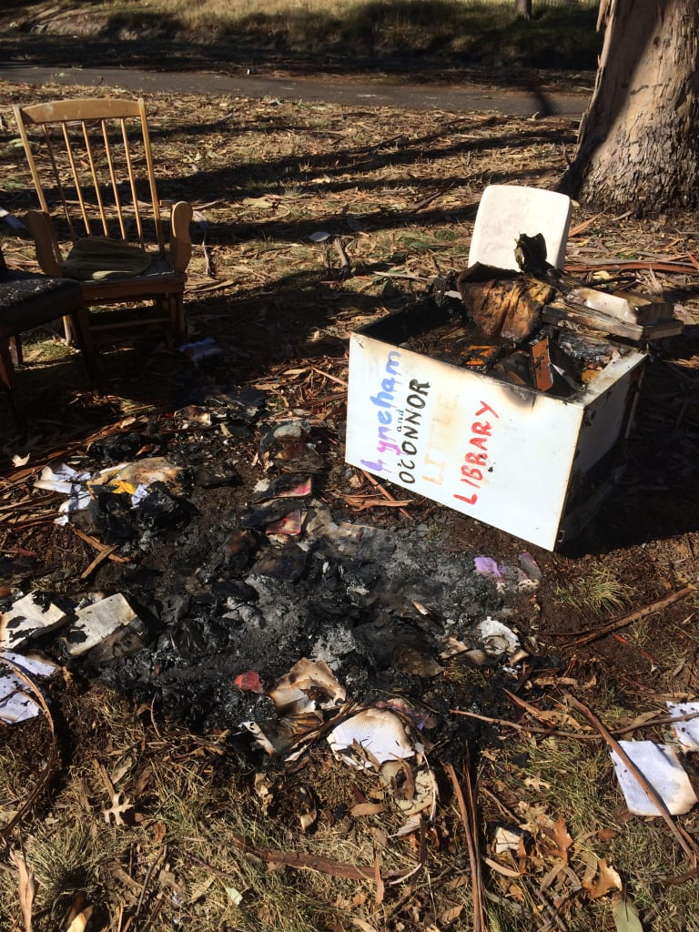 The remains of the Lyneham and O'Connor Little Library after vandals set fire to it.