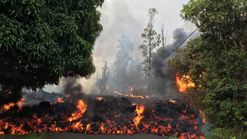 Hawaii officials airlift four residents after lava crosses road