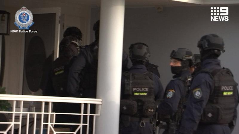 NSW Police arrest 25 in firearm raids