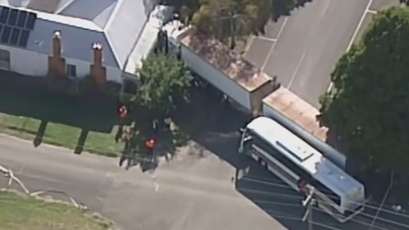 Truck ploughs into house after colliding with school bus in Inverleigh