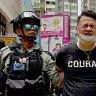 Riot police fire pepper guns in Hong Kong