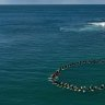 Surfers at Tuncurry beach remember Mark Sanguinetti