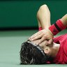 Thiem fights back to win first Grand Slam