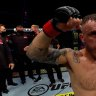 Aussie Alexander Volkanovski retained his world title in a brutal fight with Max Holloway.