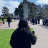 Victorian police surround a group of protesters gathered at the Shrine of Remembrance.