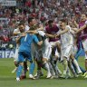 Russia beat Spain on penalties to reach quarter-finals