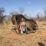 American woman pictured posing with 'dead rare giraffe' shot in South Africa sparks outrage