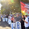 """Supporters of the Alternative for Germany party hold a flag proclaiming """"Our country, our homeland """""""