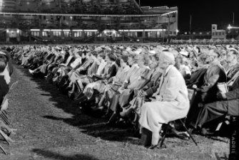Thousands of people attend the Sydney Showground to listen to visiting US evangelist, Billy Graham, 13 April 1959.