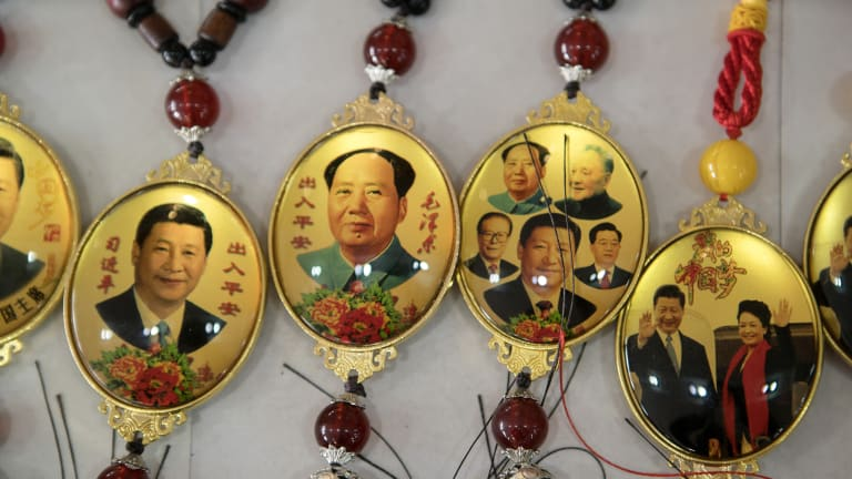 Souvenirs in Beijing featuring portraits of former Chinese leader Mao Zedong and Chinese PresidentXi Jinping.
