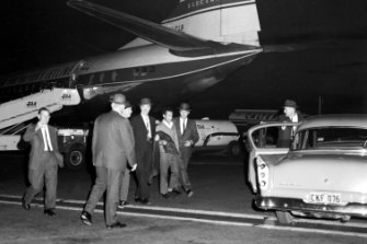 William MacDonald AKA The Mutilator arrives at Sydney's Mascot Airport from Melbourne to face possible murder charges on May 15, 1963.