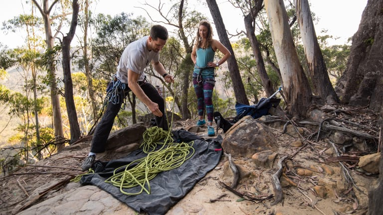 David and Brownyn Ralphs prepare their rock climbing gear.