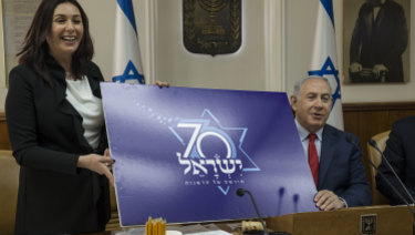 Israeli Prime Minister Benjamin Netanyahu and Culture and Sport Minister Miri Regev present a logo for Israel's 70th anniversary celebrations.