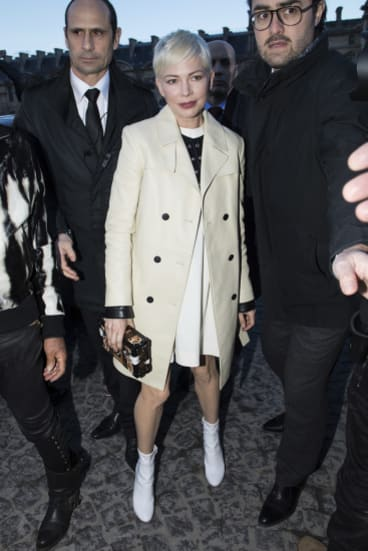 Actress Michelle Williams arrives at the Louis Vuitton show at Paris Fashion Week.