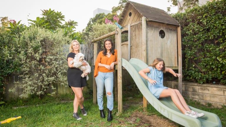 Sheridan Buchanan-Sorensen and her daughter Chloe are hosting two students, including Malia Emberson (orange top).