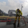 Crews pulled from fires as storms threaten state's east