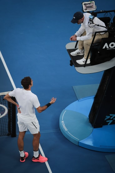 Roger Federer discusses a call with an umpire at the 2018 Australian Open.