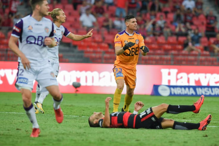 The moment: Liam Reddy reacts while Jaushua Sotirio lays sprawled on the ground.