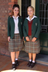 Brielle Messina and Arielle Harrison of Santa Sabina College in their kilts.