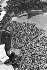Aerial view of crowds arriving at Sydney Showground on 12 April 1959.