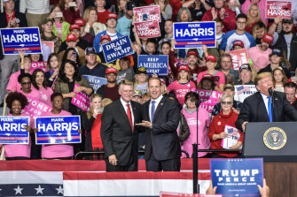 Mark Harris, left, and President Trump, far right, at a midterm rally for Harris in Charlotte.