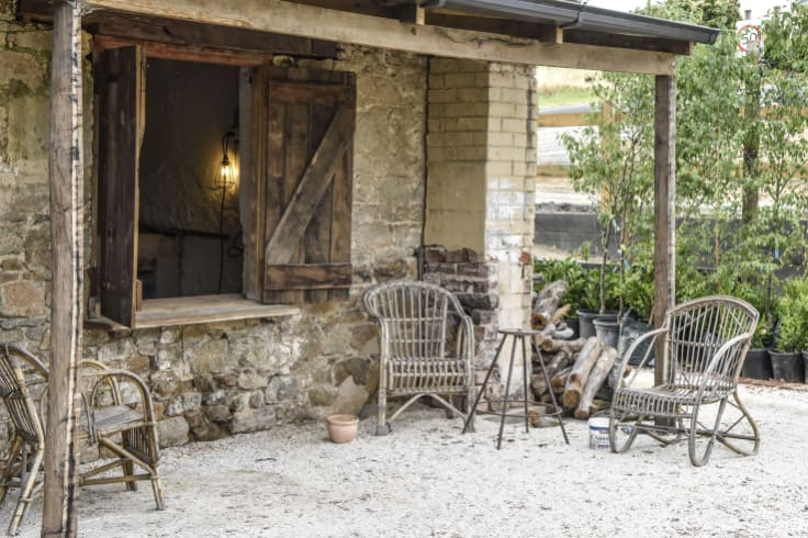 Fresh bread and pizza is served to customers through the open window of this cottage attached to The Sir George.