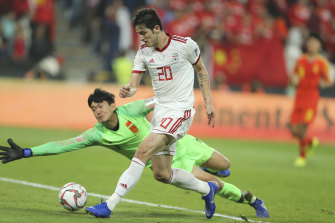 Iran's Sardar Azmoun scores his side's second goal against China.