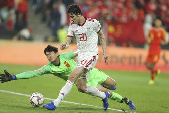 Iran's Sardar Azmoun scores his side's second goal against China.