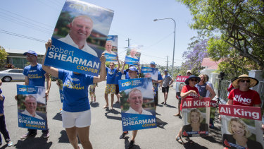 LNP and Labor supporters were on hand to watch the Premier arrive at Government House.
