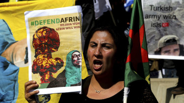 A Kurdish demonstrator in Cyprus shouts slogans in protest against the Turkish offensive targeting Kurds in the city of Afrin in Syria.