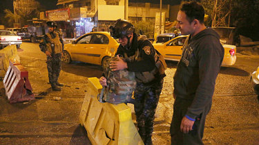 Iraqi security forces working at the scene of a suicide bombing in Baghdad.