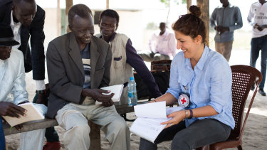 Dorsa meets William Khor Reth, commissioner of the village of Motot, to authorise the reopening of a Red Cross health unit in the village that was closed by fighting.