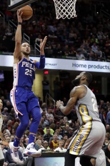 Ben Simmons scores over LeBron James.